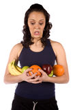 Arms full of fruit funny expression Royalty Free Stock Photos