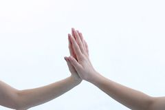 Arms and Hands. Arms extending out to touch each other with white background Stock Image