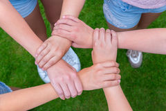 Arms with hands of children holding together Royalty Free Stock Photo