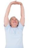 arms her senior stretching woman Στοκ Εικόνες