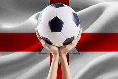 Arms holding ball with flag of Northern Ireland Stock Photos