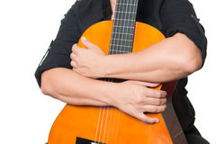 Arms hugging an acoustic guitar Royalty Free Stock Photos