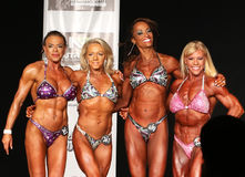 Arms Linked in Victory at 2016 NPC  Universe Women's Physique Contest Stock Photos