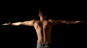 Arms outstretched. Shirtless young man with arms outstretched Stock Images