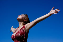 Arms outstretched to the sky. Beautiful image of a woman with her arms outstretched to the heavens, welcoming, warm and fun Stock Photography