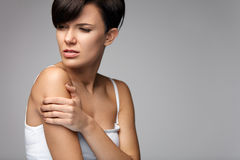 Arms Pain. Beautiful Woman Body Feeling Pain In Shoulders Royalty Free Stock Photography