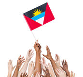 Arms Raised for the Flag of Antigua and Barbuda Stock Images