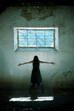 Arms raised gothic girl. Arms raised young beautiful gothic girl on dirty place stock image