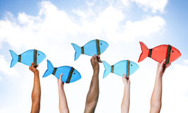 Arms Raised Holding Fishes Royalty Free Stock Photo