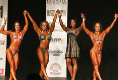 Arms Raised in Victory at 2016 NPC Universe Women's Physique Division Stock Photos