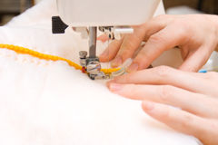 Arms and sewing-machine Stock Photos