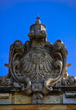 The arms of Thuringia. Stone eagle the arms on a building of court of a city of Leipzig against the blue summer sky Royalty Free Stock Image