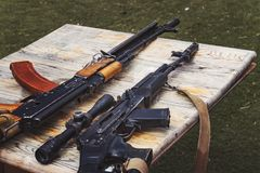Arms trafficking. different rifles on the counter in the gun shop. clandestine sale of weapons. illegal purchase of Royalty Free Stock Photo