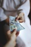 Arms transfer money Stock Photos