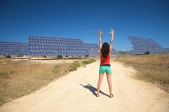 Arms up and solar panels Royalty Free Stock Images