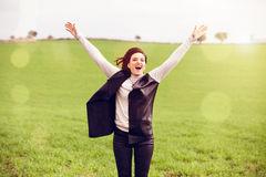 Arms up woman jumping in the countryside. Stock Photos