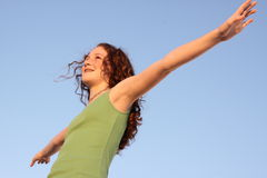 Arms wide open. Young woman with her arms extended Royalty Free Stock Photo