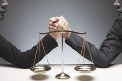 Arms wrestling behind balance