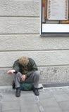 Armut in einer reichen Stadt Stockfoto