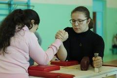 Armwrestling among girls Stock Photography
