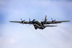 Army aircraft fly in blue sky. Military aircraft C-130 Hecules, for transportation of personel, flying in blue sky Stock Image