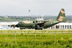 Army aircraft parked in an airport. Military aircraft C-130 Hercules, for transportation of personnel, parked in a local airport Royalty Free Stock Photo
