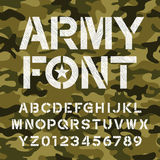 Army alphabet font. Endless camo background. Royalty Free Stock Images