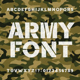 Army alphabet font. Scratched bold type letters and numbers on a seamless camo background. Stock Images