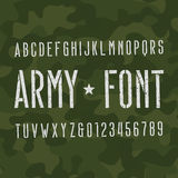 Army alphabet font. Scratched type letters and numbers on camo background. Royalty Free Stock Image