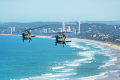 Army Blackhawks. Australian Army Black choppers fly North across Surfers Paradise and Gold Coast beaches Australia royalty free stock photography