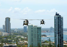 Army Blackhawks. Australian Army Black choppers fly North across Surfers Paradise and the Gold Coast royalty free stock photography