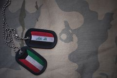 army blank, dog tag with flag of iraq and kuwait on the khaki texture background. Royalty Free Stock Image