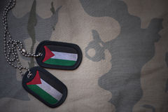 Army blank, dog tag with flag of palestine on the khaki texture background. Stock Images