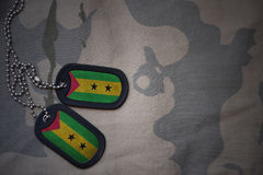 Army blank, dog tag with flag of sao tome and principe on the khaki texture background. Military concept Royalty Free Stock Photo