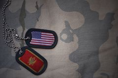 Army blank, dog tag with flag of united states of america and montenegro on the khaki texture background. Stock Images