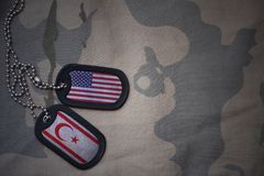 Army blank, dog tag with flag of united states of america and northern cyprus on the khaki texture background. Royalty Free Stock Photo