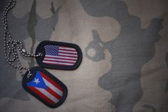 Army blank, dog tag with flag of united states of america and puerto rico on the khaki texture background. Royalty Free Stock Photography