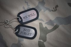 Army blank, dog tag with text we will not forget on the khaki texture background. Royalty Free Stock Photography