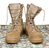 Army boots on background of money royalty free stock photos