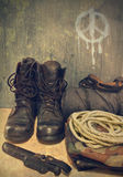 Army boots. On the background wall with a sign of pacifism Stock Image