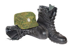 Army boots and cap over white Stock Photos