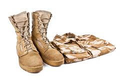 Army boots and combat shirt isolated on white background royalty free stock photography