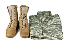 Army boots and combat shirt Stock Image