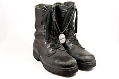 Army boots with dog-tag Stock Photo