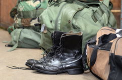 Army boots with duffle bag and dog tags. Army boots stand next to dog tags and a duffle bag royalty free stock photos