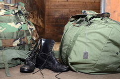 Army boots with duffle bag and dog tags. Army boots stand next to dog tags and a duffle bag Royalty Free Stock Images