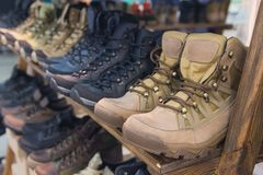 Army boots are in line at the store counter. Shoes Royalty Free Stock Images
