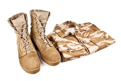Army boots and military uniform isolated on white background stock photography
