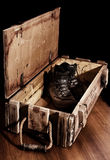 Army boots in old ammunition box Royalty Free Stock Photography