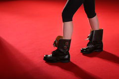 Army boots on red carpet Royalty Free Stock Photography